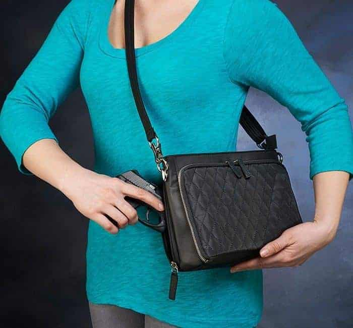 GTM/QMF-22 Quilted Shoulder Clutch Action with Gun